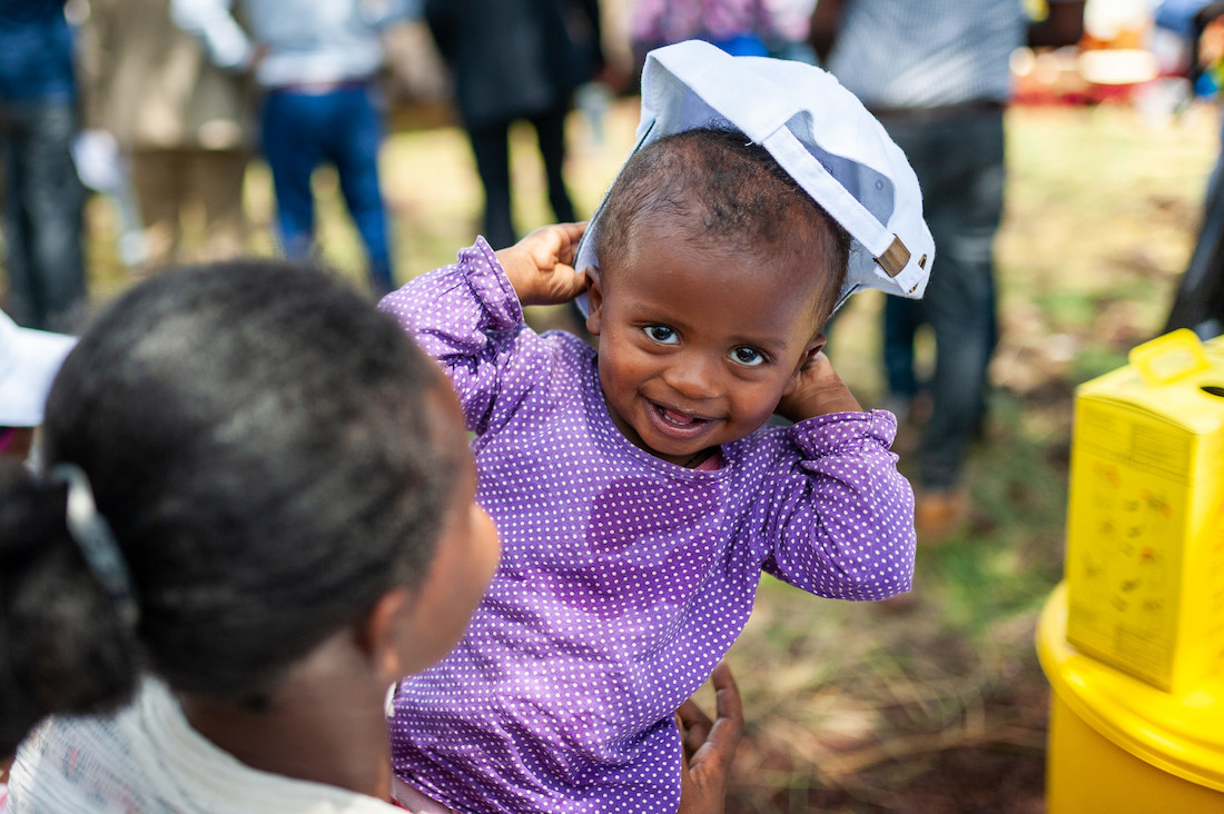 A child smiling during the introduction of the second dose of measles vaccination in Ethiopia. Credit: Gavi/2019/Frederique Tissandier.
